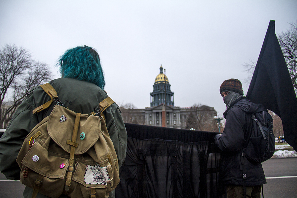 Inauguration Day protesters who wished to remain anonymous picket on Broadway on the east end of Civic Center Park. Jan. 20, 2017. (Kevin J. Beaty/Denverite)  inauguration; politics; election; protest; denver; denverite; kevinjbeaty;