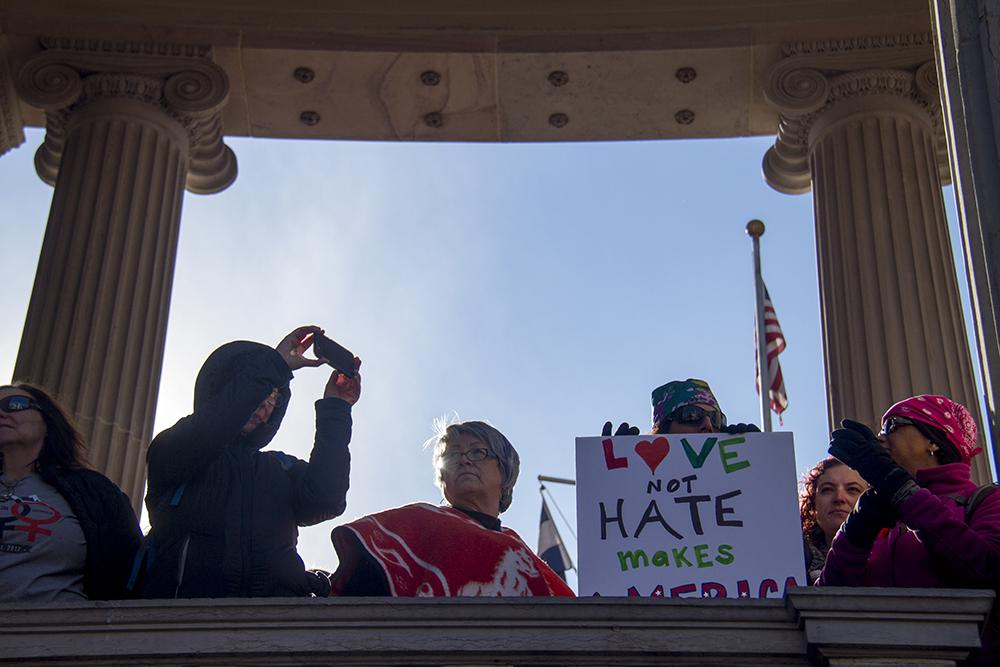 Kris Montoya stands at Civic Center Park during the Women's March on Denver. Jan. 21, 2017. (Kevin J. Beaty/Denverite)