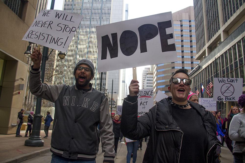 Michelle Huggins and Sam Miller march in the Women's March on Denver. Jan. 21, 2017. (Kevin J. Beaty/Denverite)