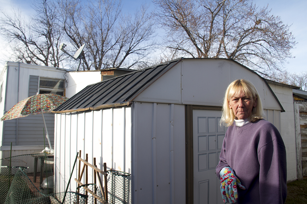 Sharon Whitehair in her backyard in the Pioneer Village Mobile Home Park. Jan. 22, 2017. (Kevin J. Beaty/Denverite)  trailer park; sharon whitehair; kevinjbeaty; denver; colorado; denverite