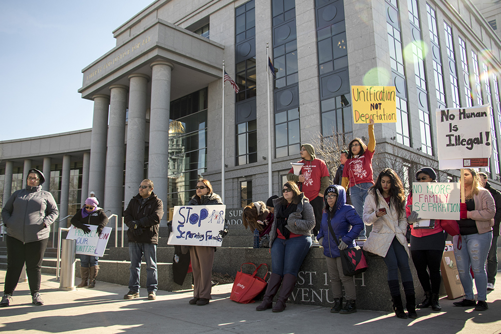 A group gathers on the steps of the Colorado Supreme Court to support SB251 and protest President Trump's executive orders on immigration. (Chloe Aiello/Denverite)  donald trump; sb251; immigration; denver; colorado; civic center park; denverite; chloe aiello; protest; vigil