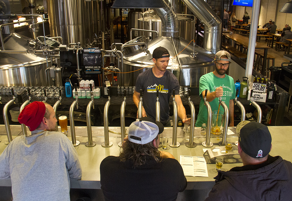 Benny Shirley (right) and John Hefter serve beers at 10 Barrel Brewing, Walnut and 27th Streets. (Kevin J. Beaty/Denverite)  beer; brewery; denver; colorado; denverite; 10 barrel brewing; rino; five points; kevinjbeaty; food;