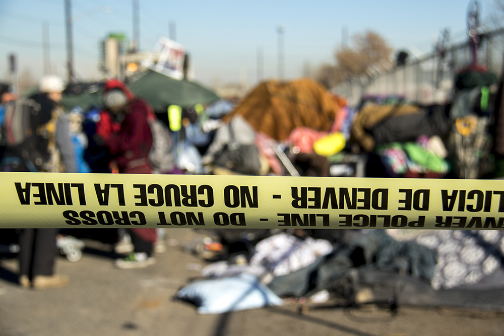 """Sweeps"" of homeless encampments at Denargo and Delgany Streets, Jan. 26, 2016. (Kevin J. Beaty/Denverite)"