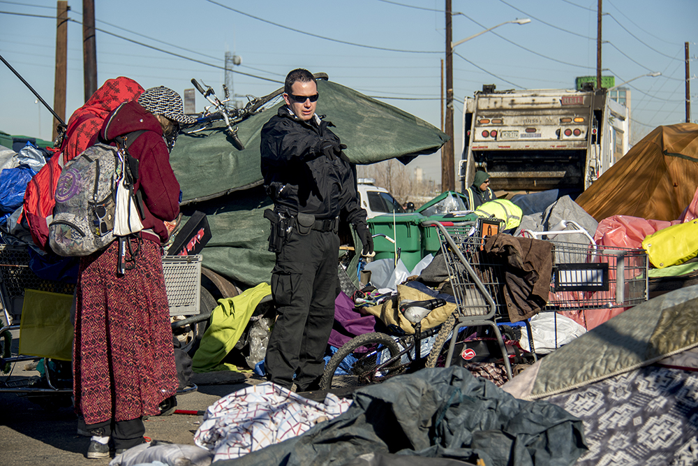 """Sweeps"" of homeless encampments at Denargo and Delgany Streets, Jan. 26, 2016. (Kevin J. Beaty/Denverite)  homelessness; sweeps; right to rest; denver; colorado; kevinjbeaty; denverite;"