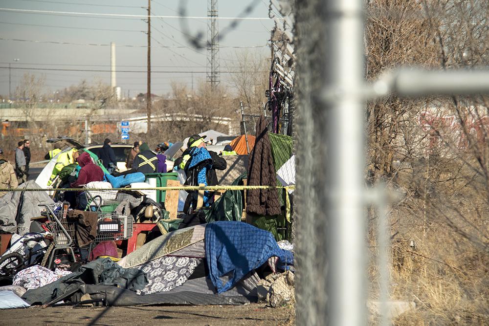 """Sweeps"" of homeless encampments at Denargo and Delgany Streets, Jan. 26, 2016. (Kevin J. Beaty/Denverite)"