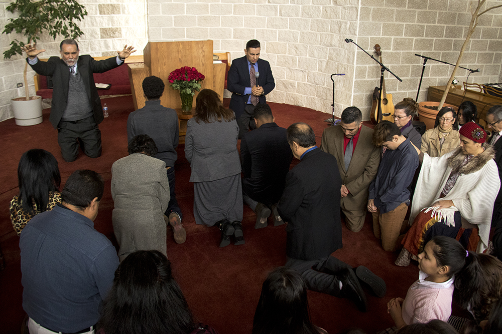 Isidro Quintana and his family pray at Seventh Day Adventist Church Reform Movement, Jan. 28, 2017. (Kevin J. Beaty/Denverite)  isidro quintana; kevinjbeaty; denverite; denver; colorado; immigration; deportation; church; worship; faith; first adventist;