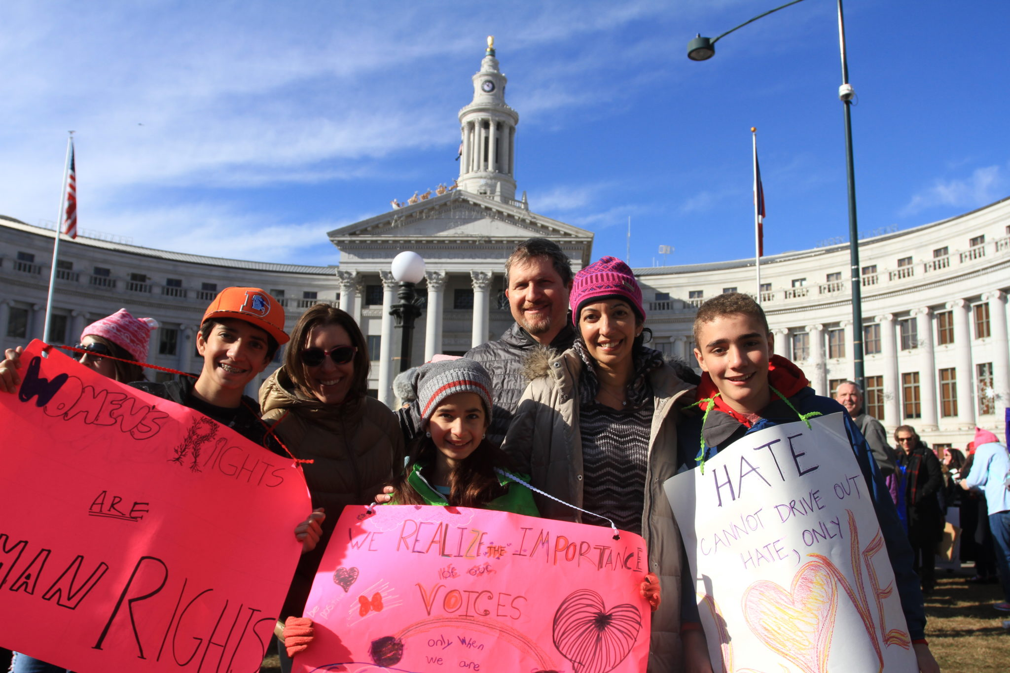 Sunit Gill (second from right) attends the Women's March on Denver with her family and neighbors on Saturday, Jan. 21, 2017.