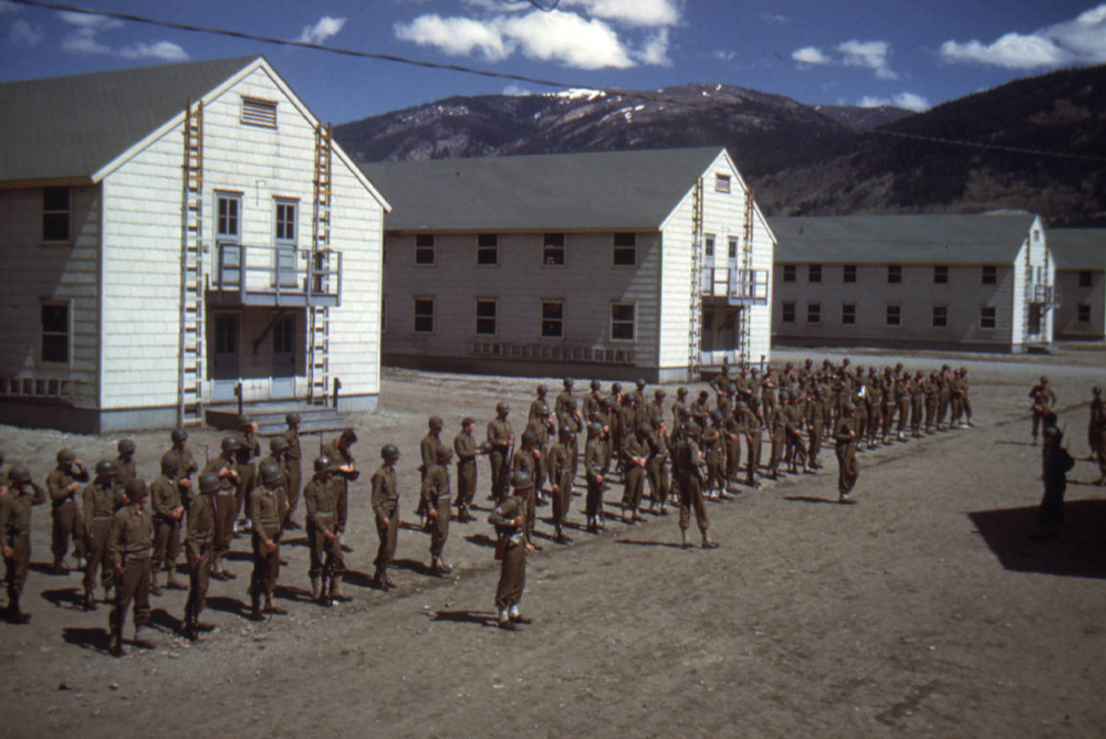 Members of the Tenth Mountain Division's 86th Regiment, F Company, drill on a Camp Hale, Colorado, street in 1943 or 1944. (Ralph Hulbert/10th Mountain Division Resource Center Collection/Denver Public Library)