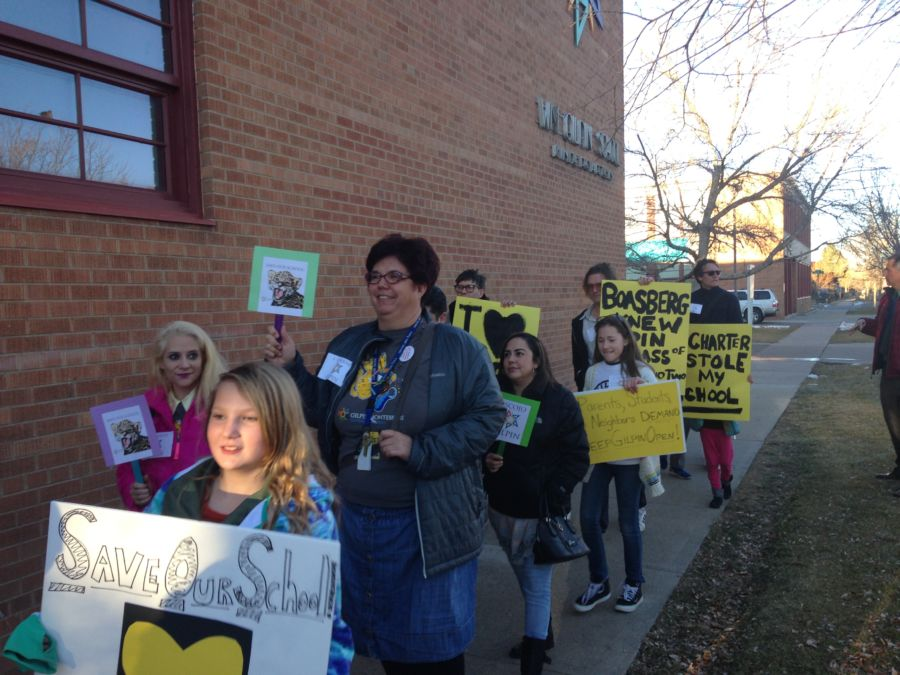 Supporters of Gilpin Montessori School marched to a school board meeting. (Melanie Asmar/Chalkbeat)