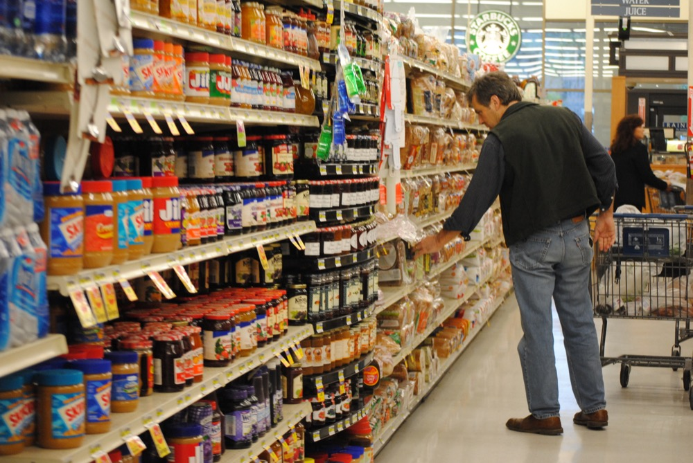 A man grocery shops. (Anthony Albright/Flickr)