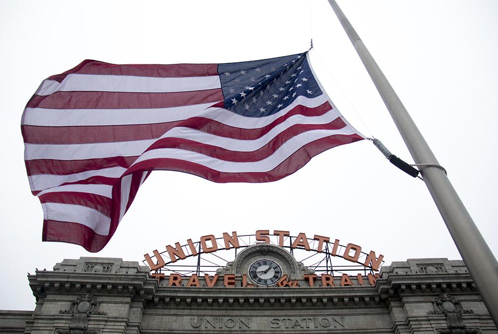 A flag flies at half staff in memoriam for RTD security guard Scott Von Lanken in front of Union Station, Feb. 1, 2017. (Kevin J. Beaty/Denverite)