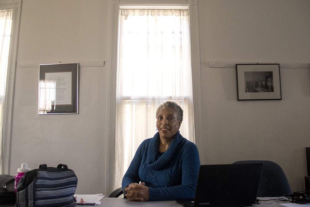 Terri Gentry poses for a photo where she's working in the Black American West Museum office house next to the main building. (Kevin J. Beaty/Denverite)  black american west museum; history; five points; kevinjbeaty; denverite; denver; colorado