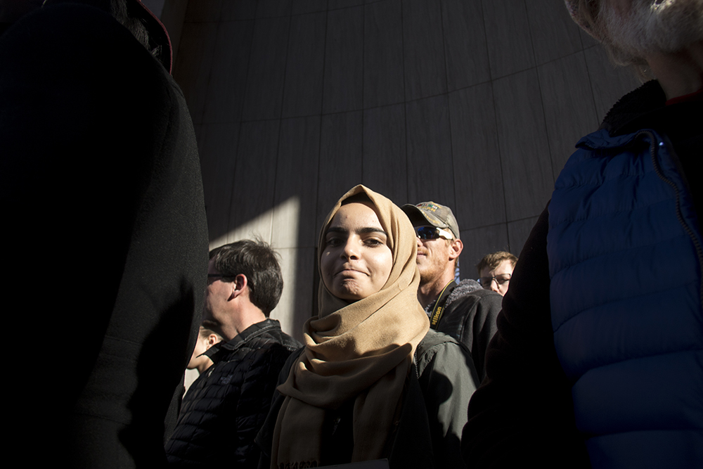 Zahra Abdulameer stands in the ampitheater at the Protect Our Muslim Neighbors Rally at Civic Center Park, Feb. 4, 2017. (Kevin J. Beaty/Denverite)  march; protest; muslim neighbors; civic center park; copolitics; kevinjbeaty; denver; denverite;