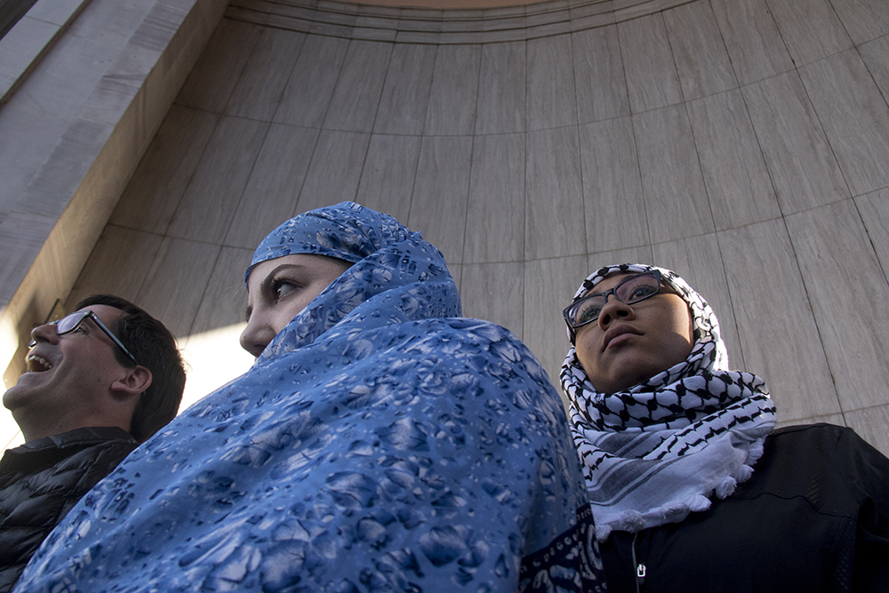 Naiyallynne Johnson (right) and Sydney Ammar stand on stage at the Protect Our Muslim Neighbors Rally at Civic Center Park, Feb. 4, 2017. (Kevin J. Beaty/Denverite)  march; protest; muslim neighbors; civic center park; copolitics; kevinjbeaty; denver; denverite;