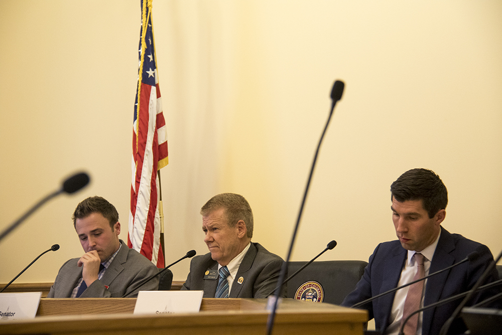 Matt Becker (left to right) and Colorado Senators Tim Neville and Owen Hill at a Senate Finance Committee meeting about a bill that would end the state's healthcare marketplace. Feb. 7, 2017. (Kevin J. Beaty/Denverite)  healthcare; copolitics; capitol; kevinjbeaty; denver; denverite; colorado;