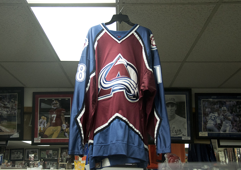 An Avalanche jersey in Bill's Sports Collectibles. (Kevin J. Beaty/Denverite)