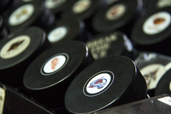 NHL hockey pucks. Bill's Sports Collectibles. (Kevin J. Beaty/Denverite)  Avalanche; bill's sports collectibles; retail; kevinjbeaty; denver; denverite; colorado;