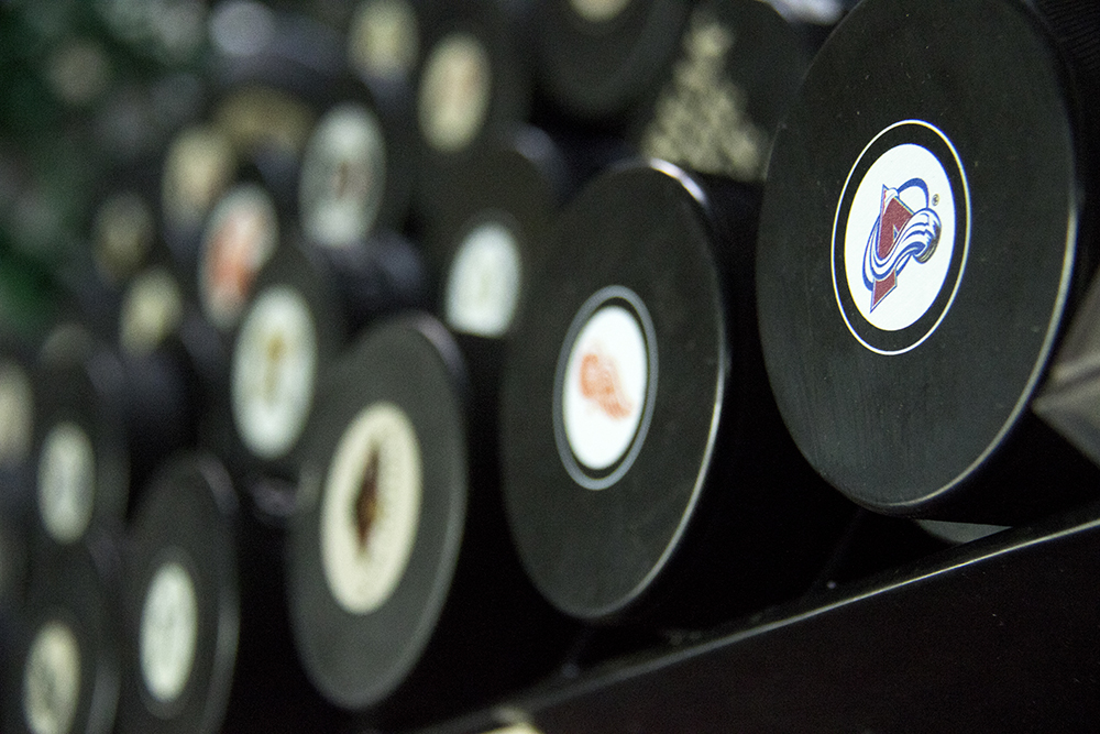 NHL hockey pucks. Bill's Sports Collectibles. (Kevin J. Beaty/Denverite)  Avalanche; bill's sports collectibles; retail; kevinjbeaty; denver; denverite; colorado;