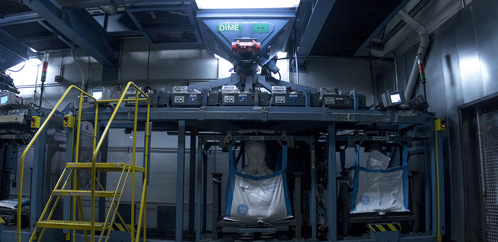 The bottom of a chute where dimes travel from the production floor to storage. Making money at the U.S. Mint. (Kevin J. Beaty/Denverite)  us mint; money; economics; denver; denverite; civic center; kevinjbeaty