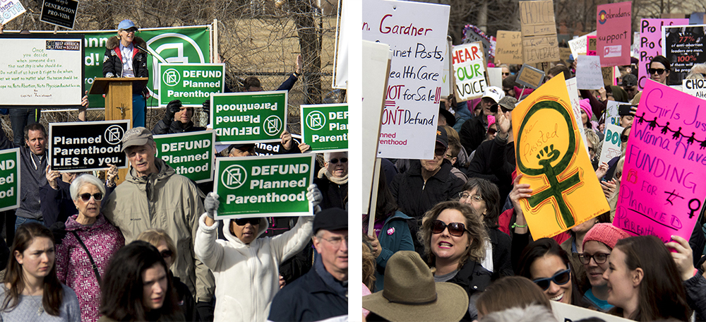 Protesters hold up signs at rallies for and against Planned Parenthood. Feb. 11, 2017. (Kevin J. Beaty/Denverite)  abortion; pro life; planned parenthood; denver; colorado; kevinjbeaty; denverite; copolitics; politics;