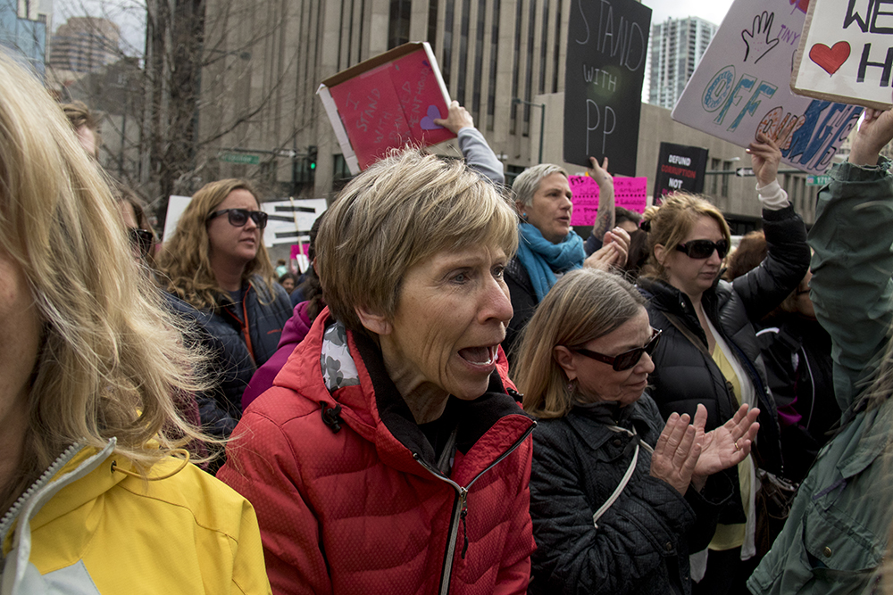 Pat Booth yells during a rally in support of Planned Parenthood at Skyline Park, Feb. 11, 2017. (Kevin J. Beaty/Denverite)  rally; planned parenthood; abortion; protest; copolitics; skyline park; denver; kevinjbeaty; denverite; colorado