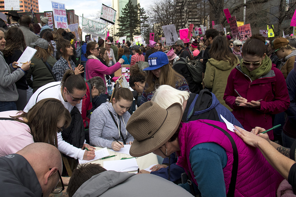 Lots of people write letters to Senator Cory Gardner. A rally in support of Planned Parenthood at Skyline Park, Feb. 11, 2017. (Kevin J. Beaty/Denverite)  rally; planned parenthood; abortion; protest; copolitics; skyline park; denver; kevinjbeaty; denverite; colorado