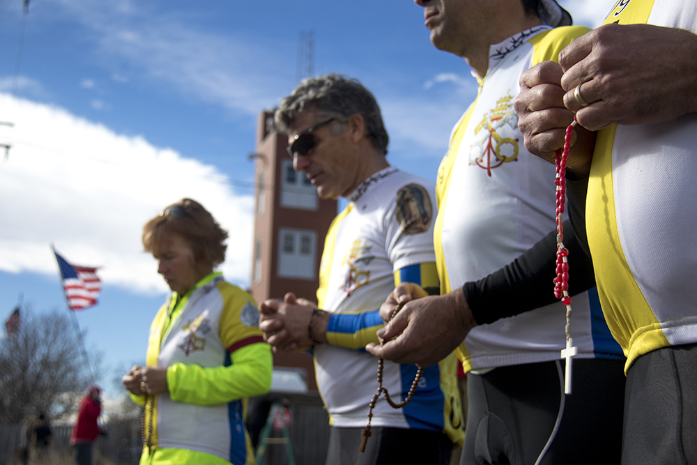 "The Ad Majorem Dei Gloriam cycling team prays with rosaries as they regularly do here outside of Planned Parenthood of the Rockies, this time during a ""Defund Planned Parenthood"" Rally, Feb. 11, 2017. (Kevin J. Beaty/Denverite)  abortion; pro life; planned parenthood; denver; colorado; kevinjbeaty; denverite; copolitics; politics;"