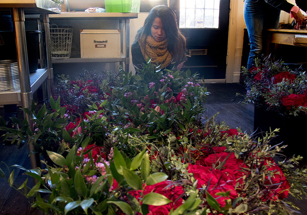 Hang Du prepares  bouquets on Valentine's Day at Flower Bombers flower delivery, Feb. 14, 2017. (Kevin J. Beaty/Denverite)  valentine's day; flowers; love; retail; kevinjbeaty; denver; denverite; colorado;