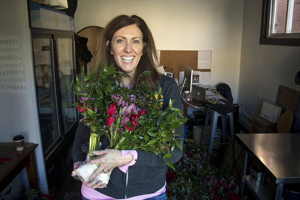 Flower Bombers founder Molly McCoy poses for a portrait on the busy Valentine's Day morning, Feb. 14, 2017. (Kevin J. Beaty/Denverite)  valentine's day; flowers; love; retail; kevinjbeaty; denver; denverite; colorado;