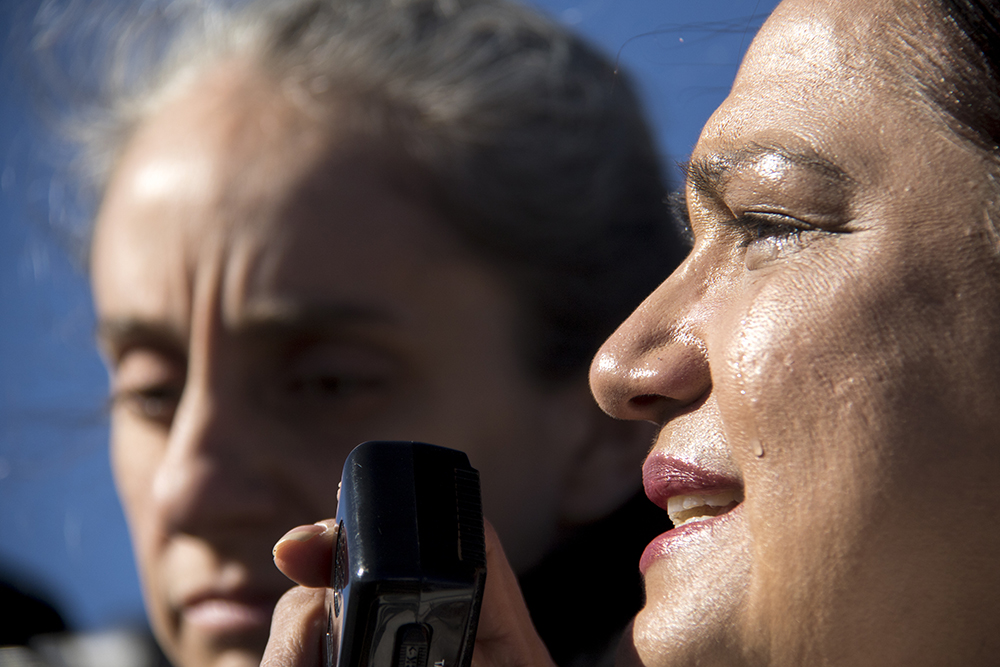 America Carbajal speaks tearfully to a crowd of Jeanette Vizguerra's supporters, Feb. 15, 2017. (Kevin J. Beaty/Denverite)  jeanette vizguerra; immigration; undocumented; deportation; sanctuary; denver; colorado; kevinjbeaty; denverite;
