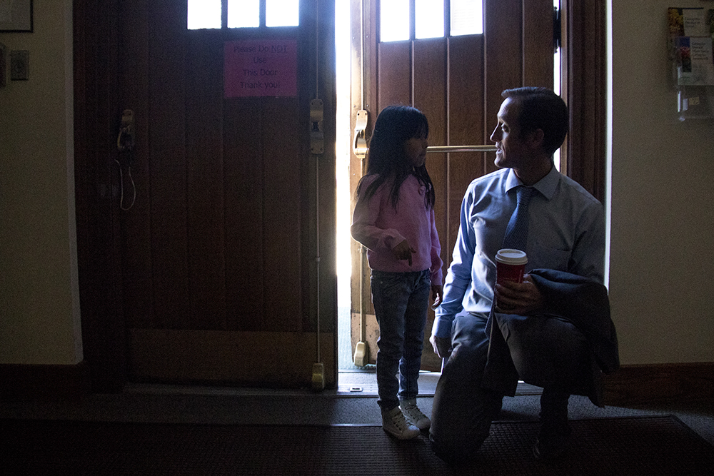 Jeanette Vizguerra's lawyer greets her daughter Zury inside the First Unitarian Society of Denver, Feb. 15, 2017. (Kevin J. Beaty/Denverite)  jeanette vizguerra; immigration; undocumented; deportation; sanctuary; denver; colorado; kevinjbeaty; denverite;