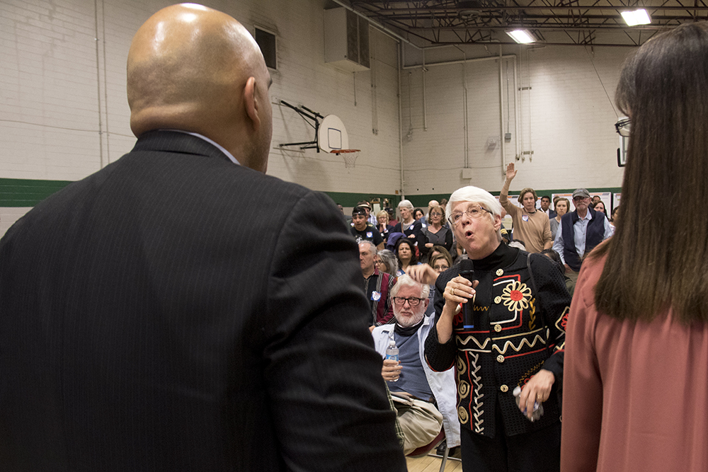 Susan Aldretti, who represents City Councilwoman Debbie Ortega in this issue, walks right up to CDOT Executive Director Shailen Bhatt while she speaks during a CDOT meeting on the I-70 expansion project at the Swansea Rec Center, Feb 16, 2017. (Kevin J. Beaty/Denverite)  i-70; i70; development; cdot; elyria-swansea; meeting; kevinjbeaty; denver; denverite; colorado;