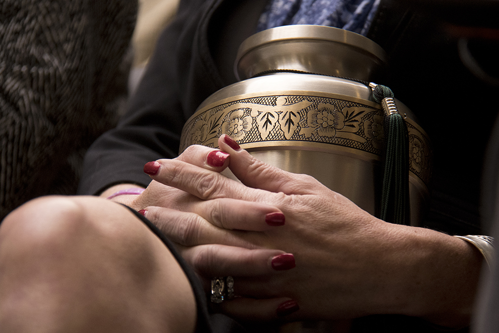 Chris Lazarus holds an urn containing the ashes of her son, whom she said died from a heroin overdose fueled by drugs sold to him by undocumented immigrants. A hearing on House Bill 1134, Feb. 22, 2017. (Kevin J. Beaty/Denverite)  immigration; capitol; copolitics; sanctuary; kevinjbeaty; denver; colorado; denverite;