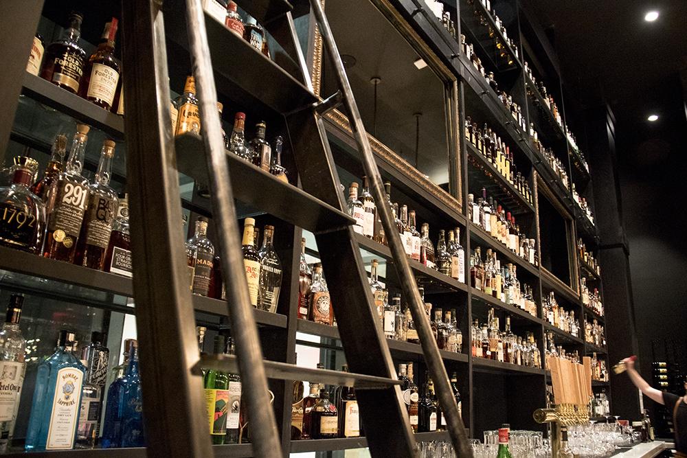 350 bottles of whiskey on the shelf at Hearth & Dram. Hotel Indigo's grand opening at 1801 Wewatta St, Feb. 23, 2017. (Kevin J. Beaty/Denverite)  denver; denverite; hotel indigo; union station;