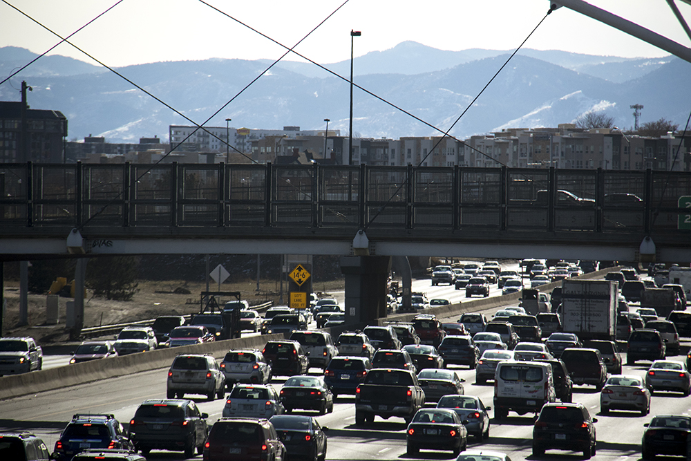 I-25 under much traffic. (Kevin J. Beaty/Denverite)  denver; colorado; kevinjbeaty; denverite; highway; i25; i-25; cars; traffic;