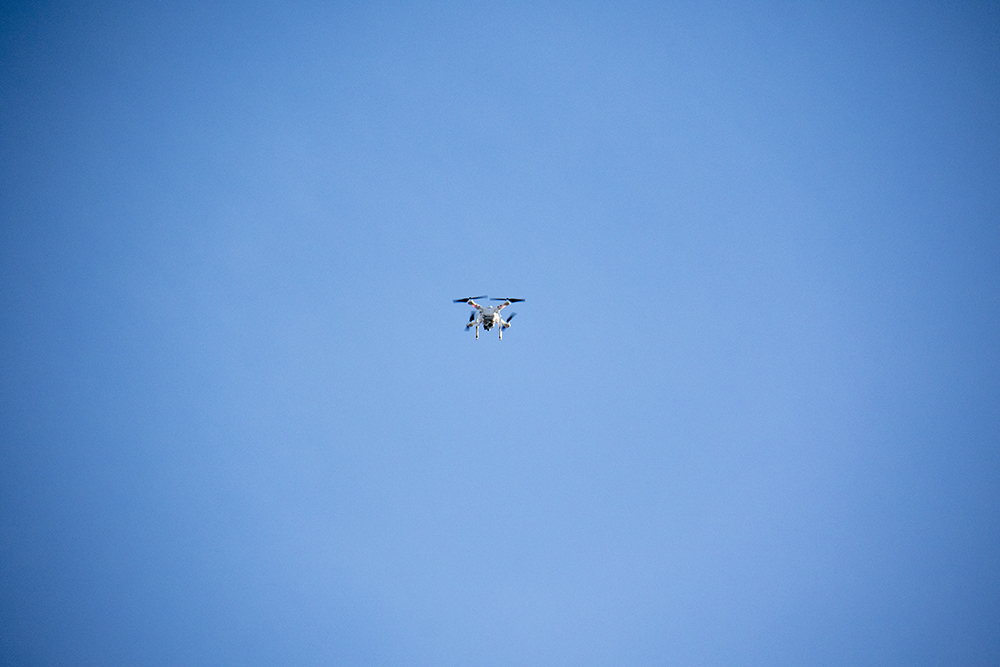 A drone with no clear operator floats overhead. A rally outside of the GEO private immigrant detention facility. (Kevin J. Beaty/Denverite)  ICE; immigration; deportation; aurora; protest; rally; denver; colorado; kevinjbeaty; denverite