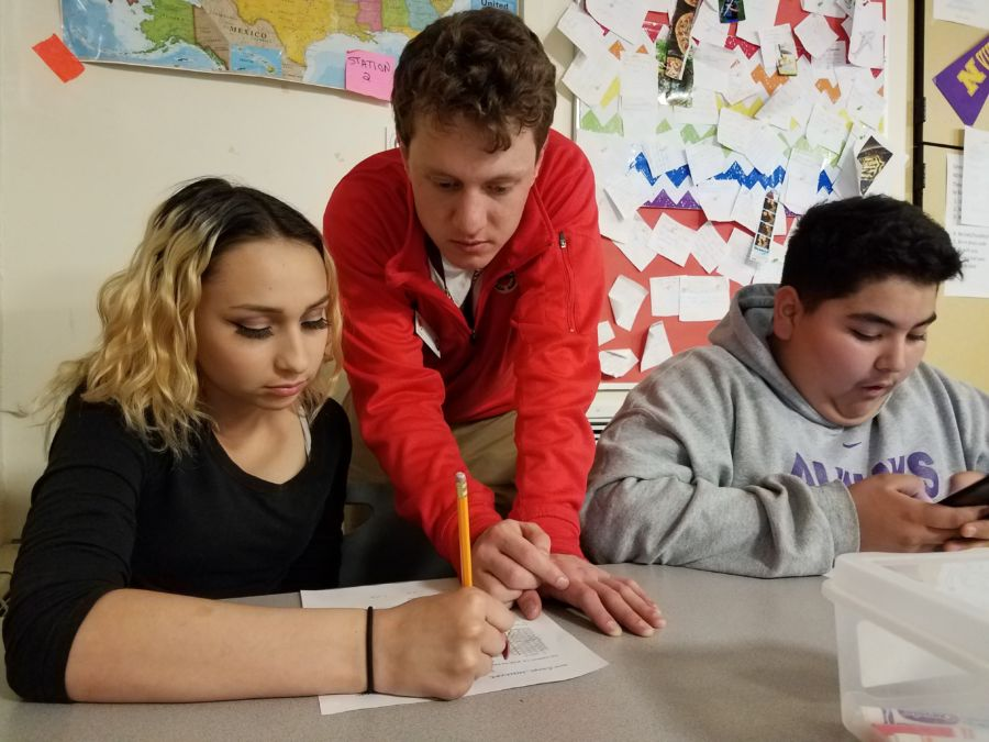Student Alaya Martinez, City Year corps member Patrick Santino and student Dorian Medina at work at North High School in Denver. (Eric Gorski/Chalkbeat)