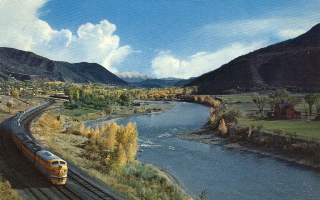 The California Zephyr train runs alongside the Colorado River in western Colorado in a postcard photo likely dating pre-1963. (Transmountain Views/Wikimedia Commons)