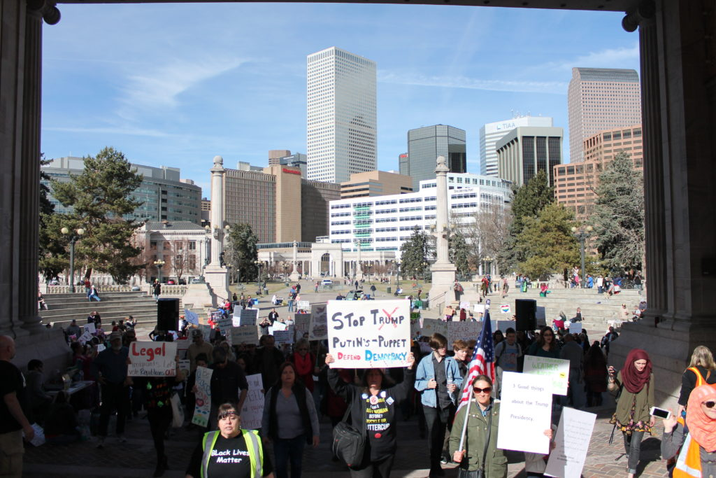 Demonstrators march out of Civic Center Park during the  Defend Our Constitution march. Feb. 18, 2017. (Ashley Dean/Denverite)