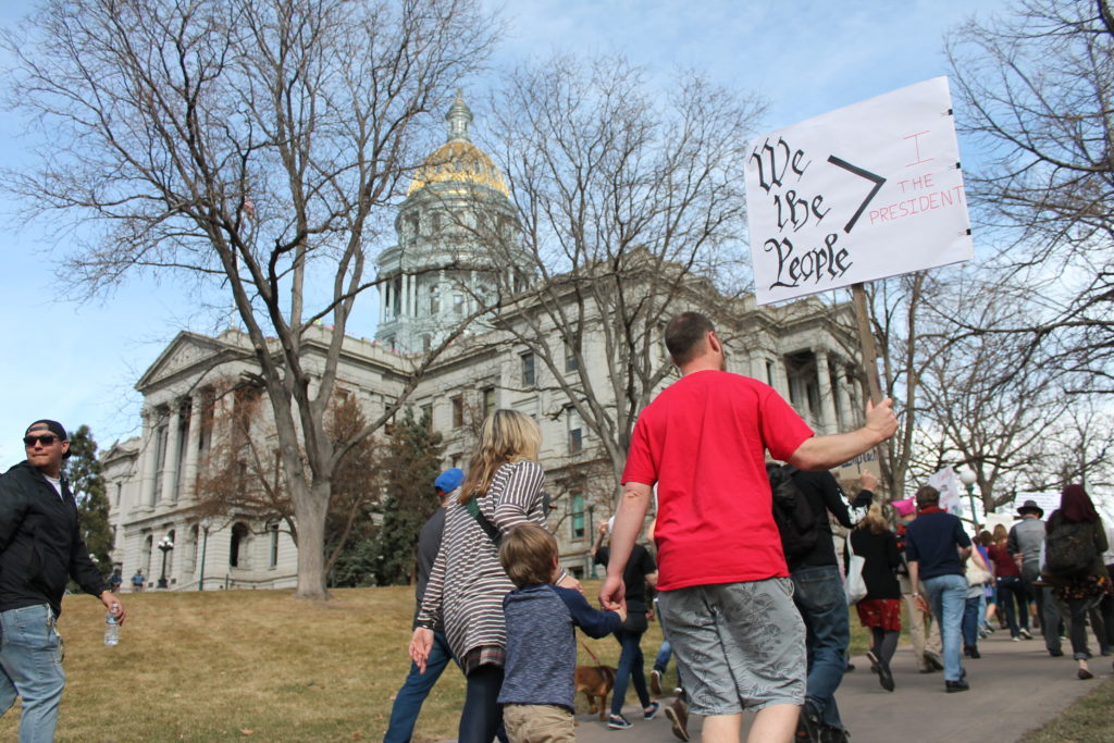 Demonstrators march along 14th Avenue in Capitol Hill during the  Defend Our Constitution march. Feb. 18, 2017. (Ashley Dean/Denverite)