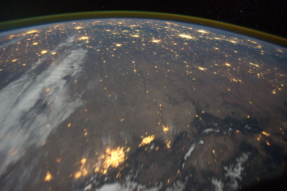 Another 2011 view east toward Kansas. My best guess is that we're looking, from left, at Cheyenne, Boulder-Denver, Fort Collins and Pueblo along the bottom edge. (ISS/NASA)