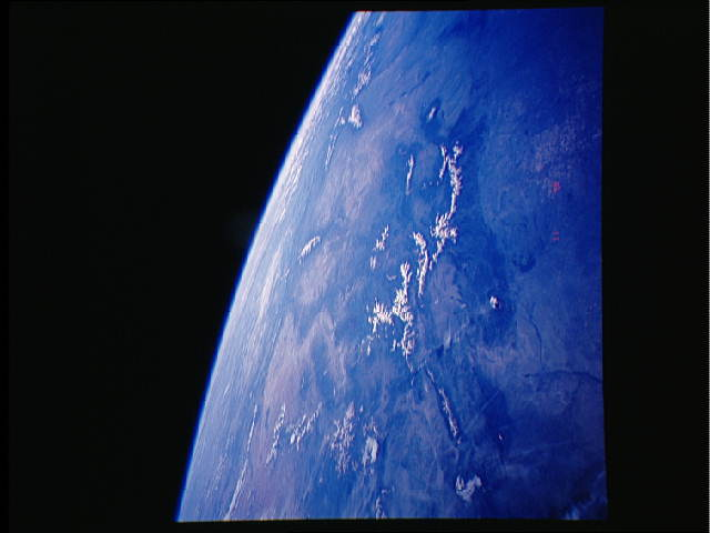 The grand sweep of the West from one of the space shuttles in 1991. Grand Junction is at dead center, the Front Range is on the righthand side of the prominent mountain range. (STS/NASA)