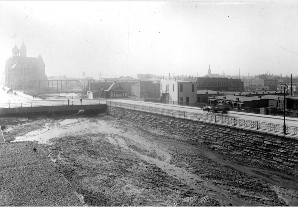 Pedestrians and horse drawn carriages use the old 14th Street viaduct along Cherry Creek in Denver, 1899. (Western History and Genealogy Department/Denver Public Library)