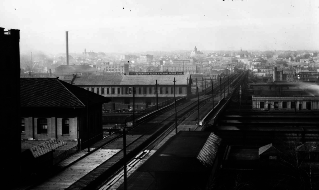 The 16th Street Viaduct stretches across the railyard toward Highland. The turreted building at right is the future site of Commons Park. (Western History and Genealogy Department/Denver Public Library)