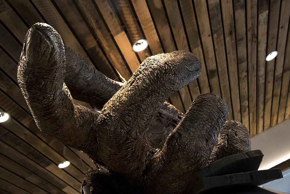 A giant wooden hand by Colorado artist Andrew Ramiro Tirado. The Dairy Block, Mar. 1, 2017. (Kevin J. Beaty/Denverite)  dairy block; food; the maven hotel; public art; development; construction; ballpark; lodo; denver; colorado; denverite; kevinjbeaty;