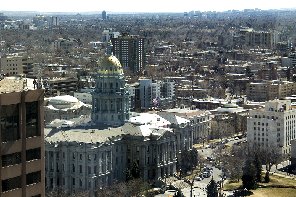 The Capitol seen from Luis Benitez's office in the state Outdoor Recreation Industry Oddice. (Kevin J. Beaty/Denverite)  denver; colorado; kevinjbeaty; denverite; skyline; cityscape;
