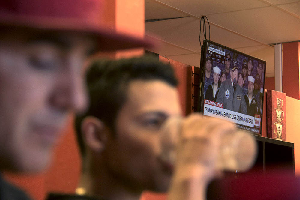 Isidro Quintana and his employee eat lunch while the President is broadcasted in the background, Mar. 2, 2017. (Kevin J. Beaty/Denverite)  castle rock; isidro quintana; construction; immigration; kevinjbeaty; denverite; colorado;