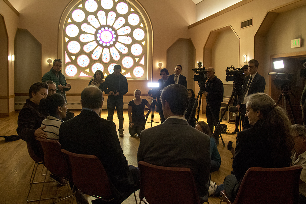 Reporters fill the room as U.S. Representative Jared Polis meets with Jeanette Vizguerra at the First Unitarian Society of Denver where she's taken sanctuary to avoid deportation, Mar. 3, 2017. (Kevin J. Beaty/Denverite)  immigration; undocumeted; jeanette vizguerra; first unitarian society; capitol hill; denver; colorado; kevinjbeaty; denverite