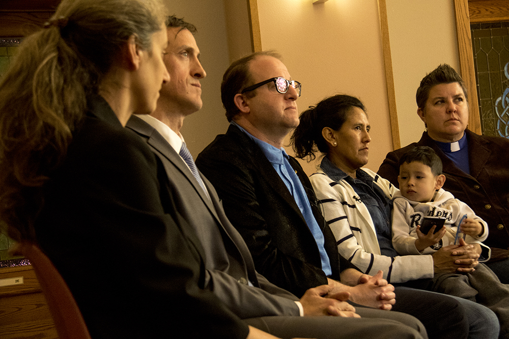Jennifer Piper (left to right), immigration attorney Hans Meyer, U.S. Representative Jared Polis, Jeanette Vizguerra and Pastor Anne Dunlap at the First Unitarian Society of Denver where she's taken sanctuary to avoid deportation, Mar. 3, 2017. (Kevin J. Beaty/Denverite)