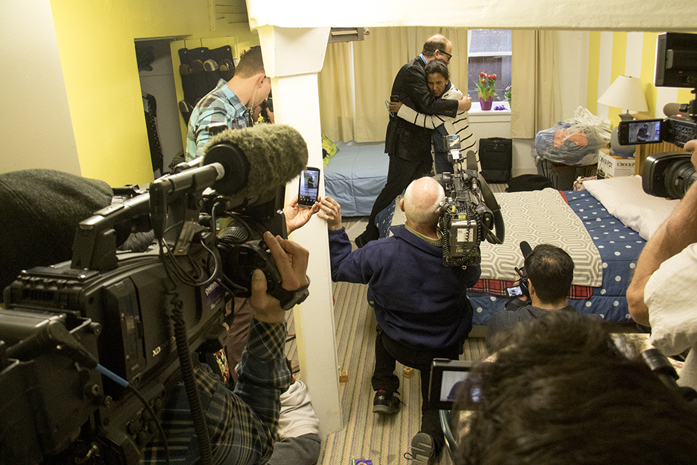Reporters fill Jeanette Vizguerra's bedroom during U.S. Representative Jared Polis' visit. The First Unitarian Society of Denver where she's taken sanctuary to avoid deportation, Mar. 3, 2017. (Kevin J. Beaty/Denverite)  immigration; undocumeted; jeanette vizguerra; first unitarian society; capitol hill; denver; colorado; kevinjbeaty; denverite